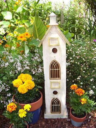 Marigolds with birdhouse